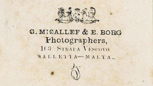 The back of the photo of the Franciscan friar, showing the Royal Arms' emblem and the studio address of photographers G. Micallef & E. Borg.