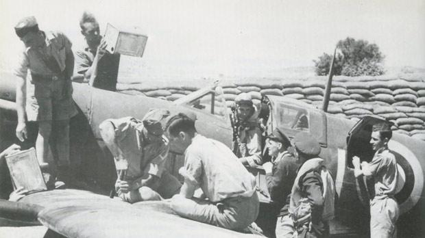 Army and RAF personnel refuelling and rearming a Spitfire in its protective pen. Photo: The Air Battle for Malta, James Douglas-Hamilton