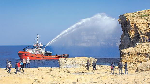 Tug Malta's Spinola vessel recreating the archway with a jet of sea water. Photos: Anthony Grech