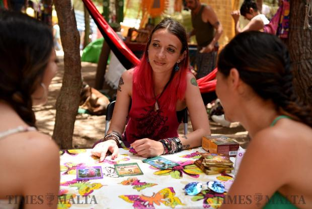 A woman reads tarot cards to two people during the Earth Garden festival in Ta' Qali on June 3. Photo: Mark Zammit Cordina