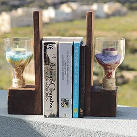 The company's bookend made from wooden pallets and wine glass bottles.