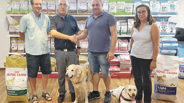 Andrew Borg Cardona, general manager of Borg Cardona & Co. Ltd (right), shakes hands with Joseph Stafrace, the newly elected chairman of the Malta Guide Dogs Foundation, after the signing of their multi-year sponsorship. With them are Lilibeth Cachia, secretary of the MGDF, Malcolm J. Naudi, PRO, the guide dog Mazzi and the guide dog puppy Angel.