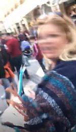 Footage shot by one of the protesters showed a woman swearing and then lashing out.
