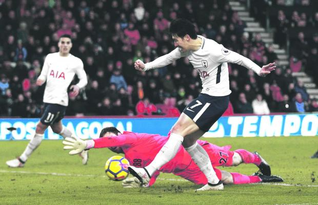 Son scores Tottenham's third goal against Bournemouth.