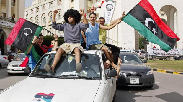 Libyans celebrate Muammar Gaddafi's death in Tripoli. Photo: Abdel Magid al-Fergany, PA
