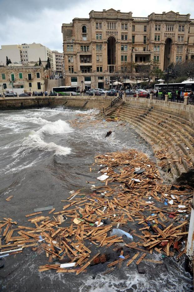 Wood planks collect in Balluta Bay in the aftermath of the storm on October 30. Photo: Chris Sant Fournier