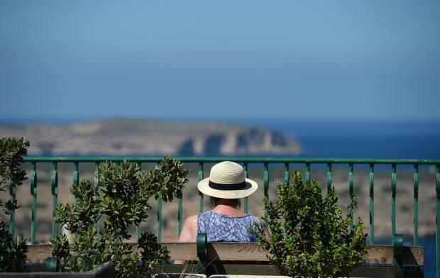 A lady enjoys the sun on a bench in Mellieha on September 6. Photo: Matthew Mirabelli