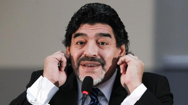 Former Argentine soccer star Diego Maradona gestures during a news conference in Naples