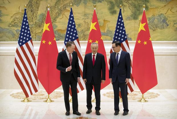 US Trade Representative Robert Lighthizer, Chinese Vice Premier and lead trade negotiator Liu He and US Treasury Secretary Steven Mnuchin talk before the opening session of trade negotiations.