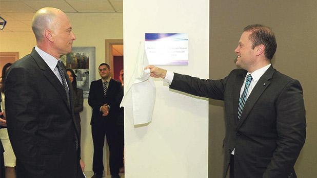 Nexia BT managing partner Brian Tonna with Prime Minister Joseph Muscat
