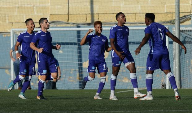 Kevaugh Atkinson (second left) celebrates one of his goals against Mosta. Photo: Matthew Mirabelli