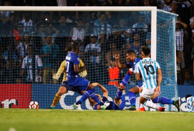 Lautaro Martinez of Argentina's Racing scores a goal.