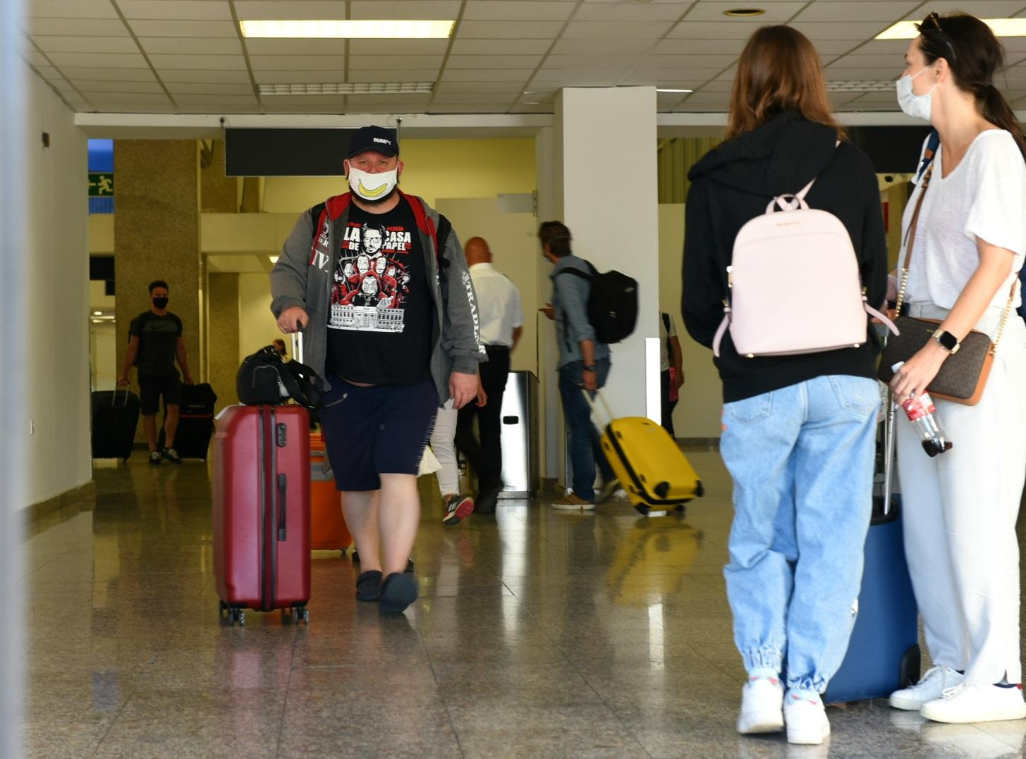 Passengers have to wear masks when they walk through the terminal building. Photo: Chris Sant Fournier