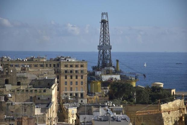 An oilrig towers over buildings as it moves out of Grand Harbour on November 22. Photo: Mark Zammit Cordina