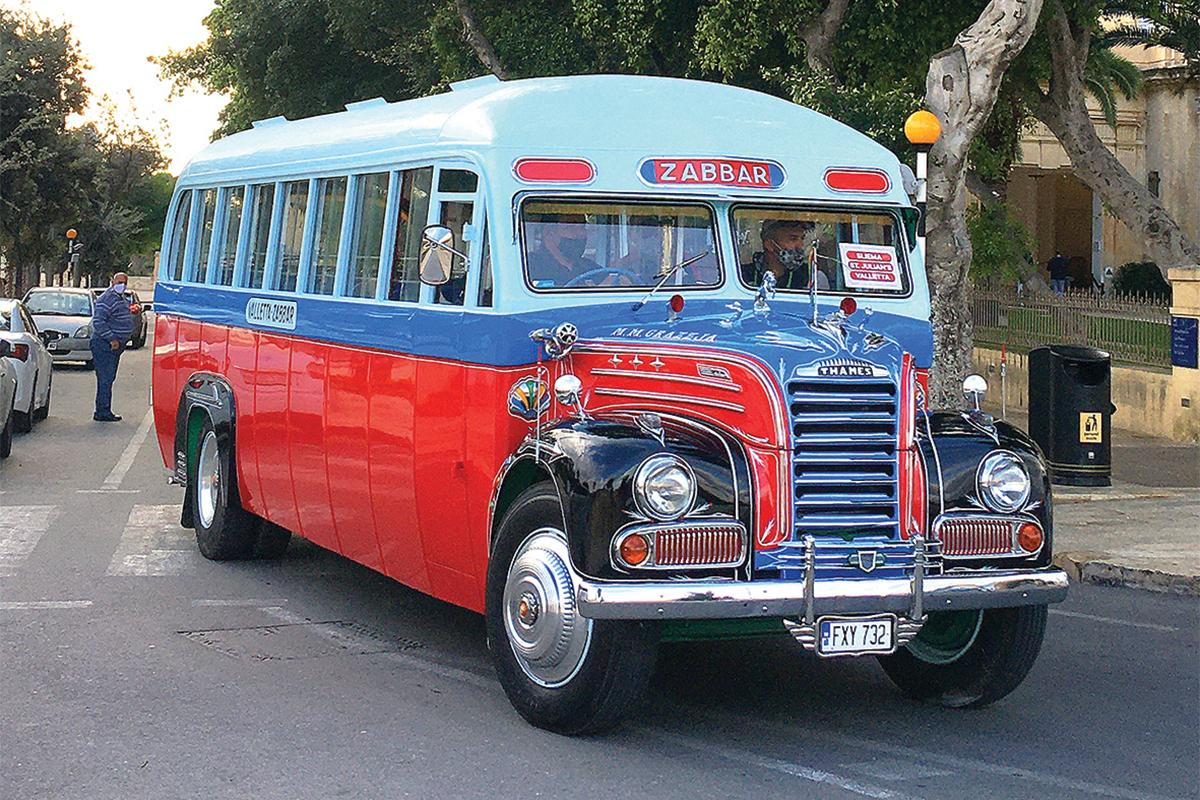 A bus in the red and blue livery that was used on the Żabbar route.
