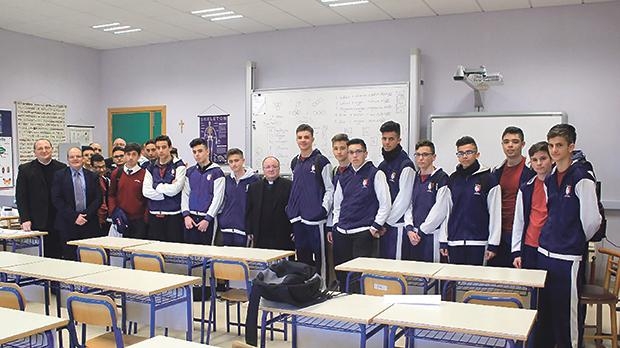 Archbishop Charles Scicluna (centre) with fifth year students in the Religion class at St Margaret College's Senior Secondary School, Verdala, Cospicua, accompanied by school head Joe Elul, PRO and teacher Martin Azzopardi SDC, spiritual director Fr Carmelo Spiteri OCD, and Fr Reuben Gauci, coordinator of spiritual development in schools.