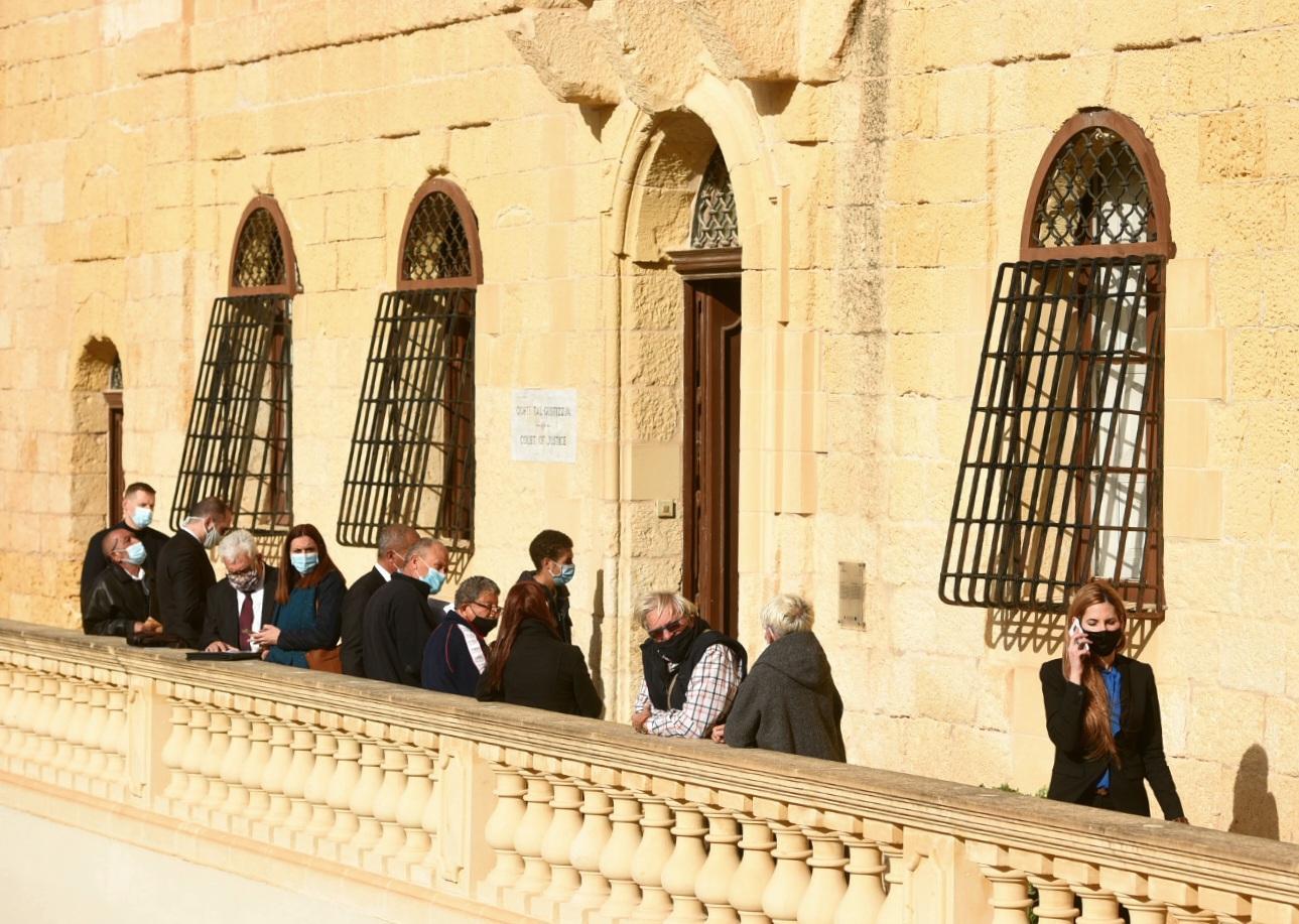 People wait outside the Gozo law court building. Photo: Chris Sant Fournier