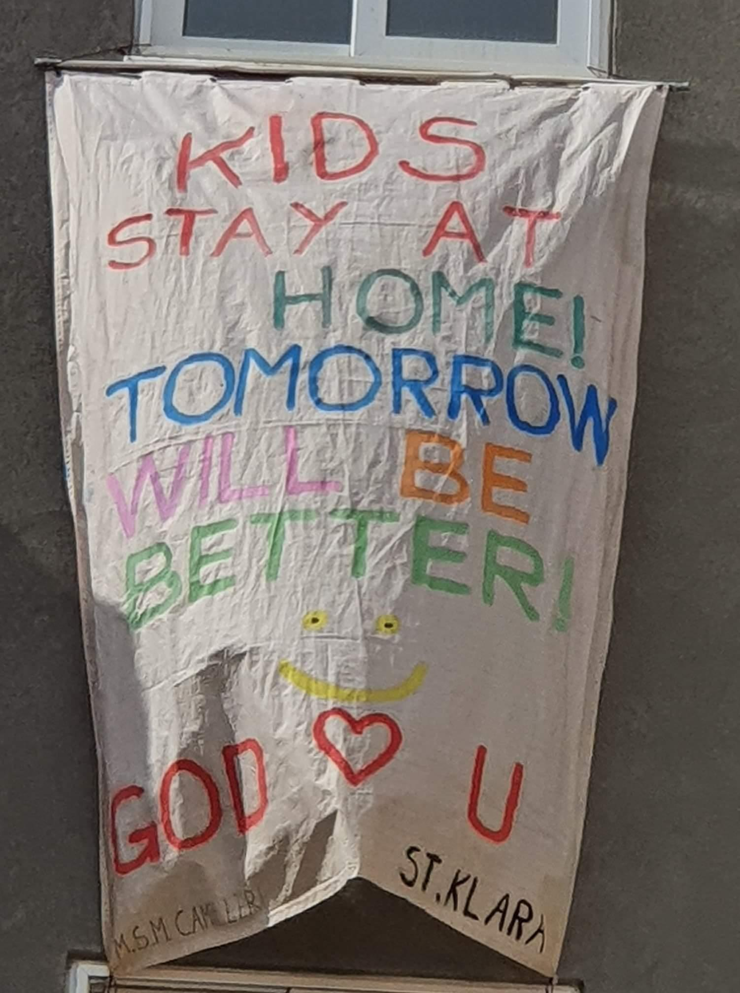 Megan (10), Samuel (9) and Meryl (6) went all out with a massive banner, urging other children to stay home.