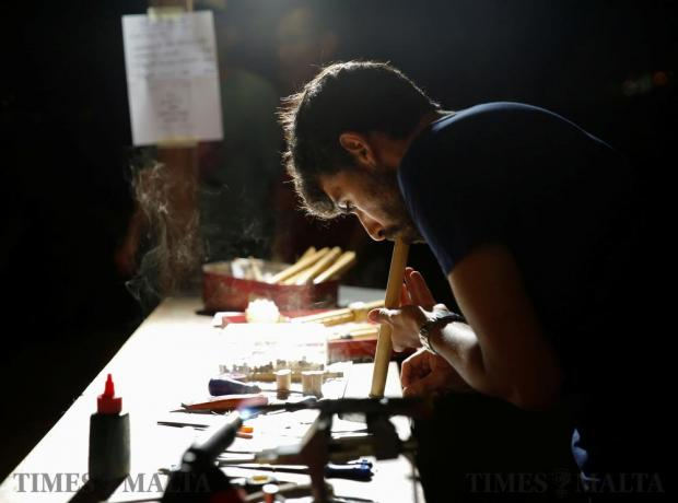 An artisan makes a Maltese traditional wind instrument at an artisans' market during the Ghanafest folk music festival, a showcase of Maltese folksong and international music folk fusion music, at the Argotti Gardens in Floriana on June 10. Photo: Darrin Zammit Lupi