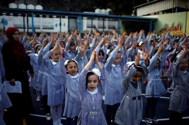 Children do their morning exercises at a UNRWA-run school. Photo: Reuters
