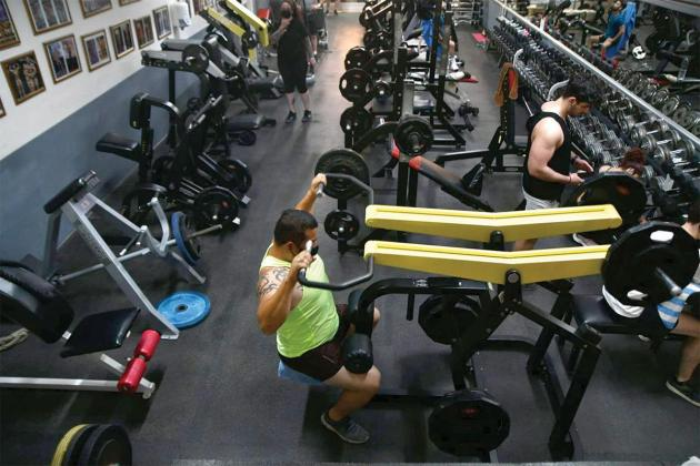 As gyms reopen, instructors advise taking it easy with workouts at first