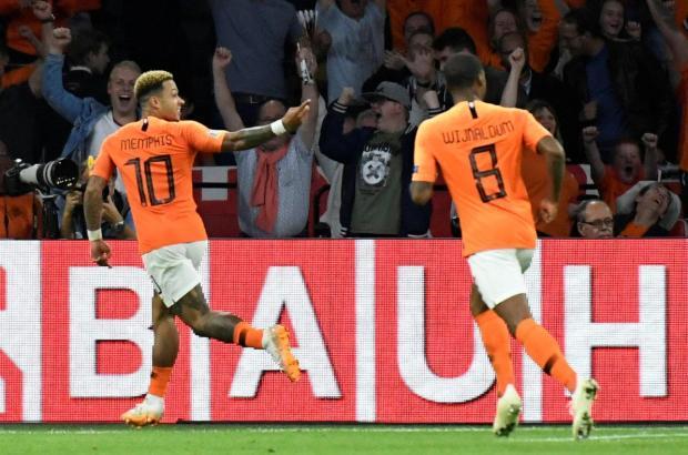 Netherlands' Memphis Depay celebrates his goal with Georginio Wijnaldum