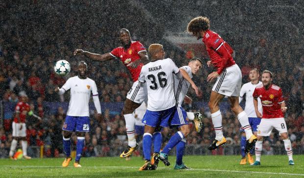 Marouane Fellaini (right) scores Man. United opener against Basel.
