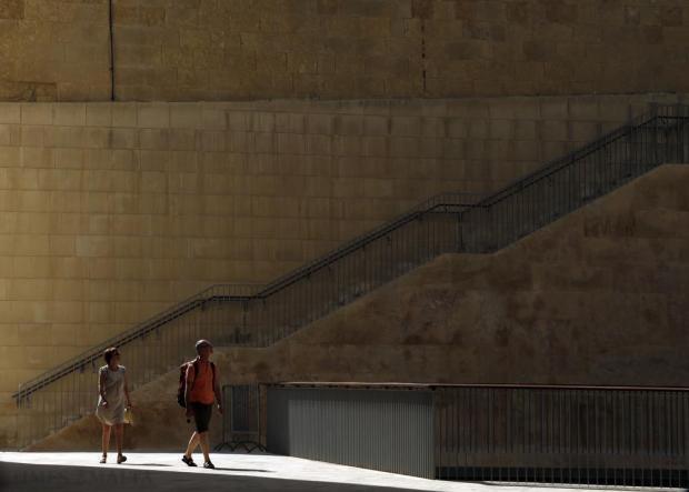 Tourists walk outside St James Cavalier in Valletta on June 17. Photo: Darrin Zammit Lupi