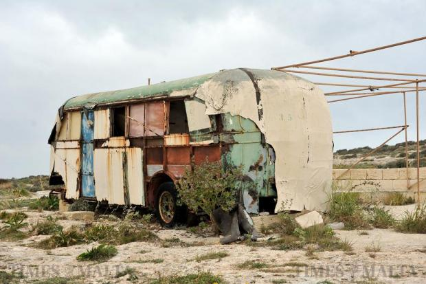 The remains of an old Maltese bus are seen at Armier on March 23. The bus has apparently been used as a boathouse for some time but has since been abandoned and left to rot. Photo: Chris Sant Fournier