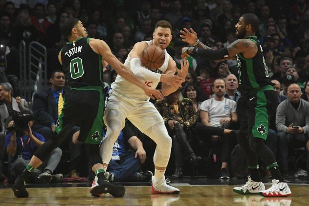 LA Clippers forward Blake Griffin (32) attempts to control the ball between Boston Celtics forward Jayson Tatum (0) and Boston Celtics guard Kyrie Irving (11) during the first half at Staples Center. Photo: Richard Mackson-USA TODAY Sports