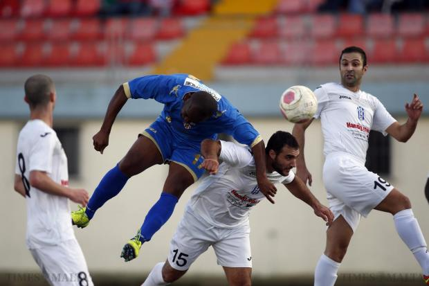 Msida St Joseph's Uchenna Anyanwu (2nd left) attempts to score during their Division One football match against Gudja United at the Centenary Stadium in Ta' Qali on December 20. Photo: Darrin Zammit Lupi