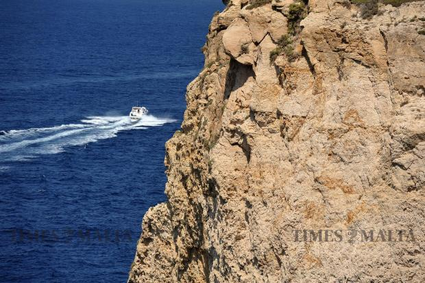 A yacht passes under the Mtahleb cliffs on September 4. Photo: Chris Sant Fournier
