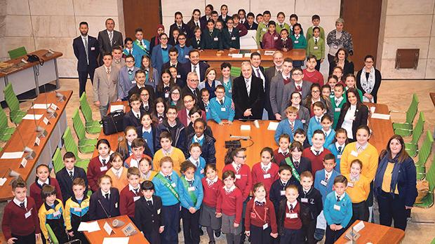 Students at the Eco-Schools Parliament session with the Speaker and MPs (centre). Photo: www.tufigno.com