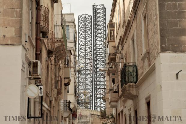 The towering legs of a rig dominates the background of this Senglea street on February 8. Photo: Chris Sant Fournier