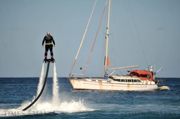 A man rides a fly board in Spinola Bay on March 7. Photo: Chris Sant Fournier