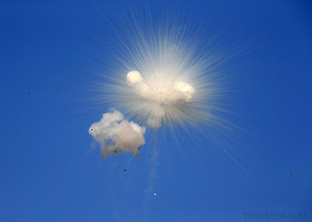 A petard explodes in the air during the religious feast of St Julian, patron of the town of St Julian's on August 24. Photo: Darrin Zammit Lupi