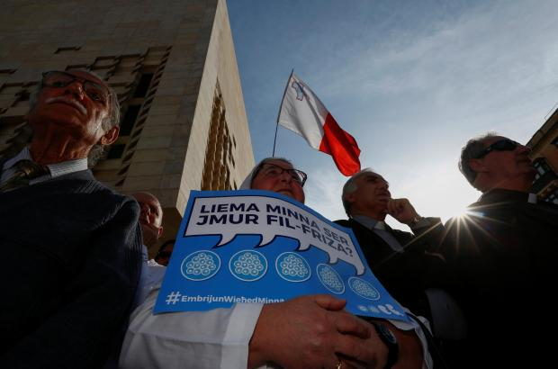 A nun holds up a placard asking 'which one of us will end up in a freezer?' at a rally against IVF legal changes in Valletta. Photo: Darrin Zammit Lupi/Reuters