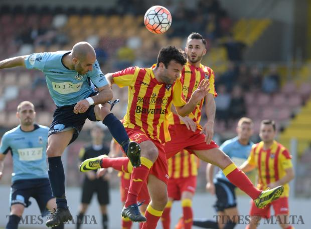 Sliema's Stefano Bianciardi (left) and Senglea's Keith Tanti clash in mid air during their FA Trophy match at Hibernians Stadium in Paola on February 18. Photo: Matthew Mirabelli