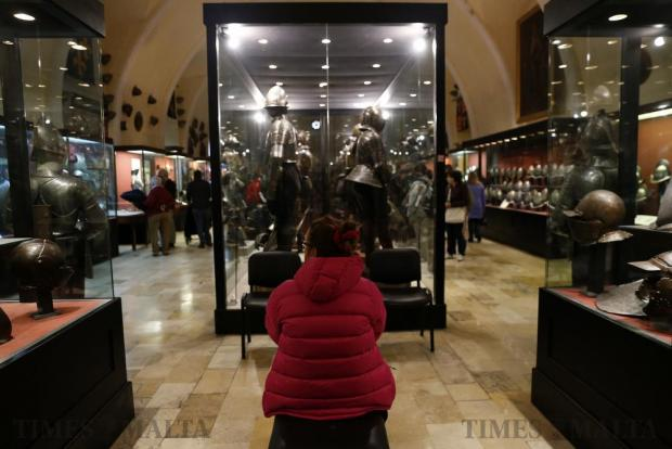 A woman visits the Palace Armoury in Valletta on December 8. Heritage Malta opened practically all its sites and museums for free for the day, in a bid to promote the island's rich historical, archaeological and artistic heritage. Photo: Darrin Zammit Lupi