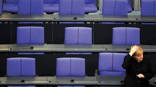 German Chancellor Angela Merkel sits alone after the third voting round of the presidential election yesterday at the Bundestag in Berlin. Photo: Johannes Eisele/afp