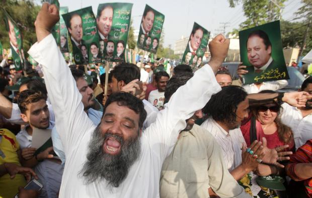 Supporters of Pakistan's Prime Minister Nawaz Sharif celebrate following the Supreme Court's decision in Lahore.