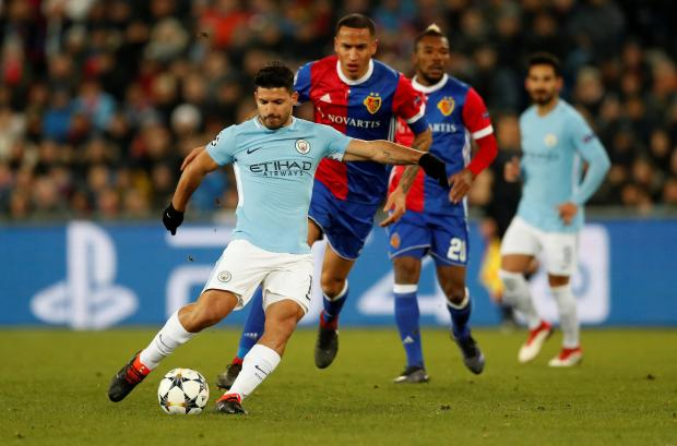 Sergio Aguero scores Manchester City's third goal against Basel.