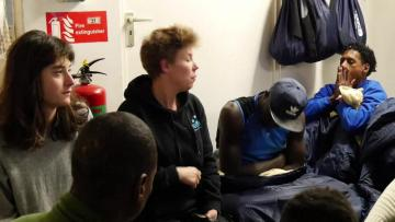 Migrants land in Sicily as ship crew faces uncertain fate | Migrants on board the Sea Watch cheer after they were granted landing in Italy.