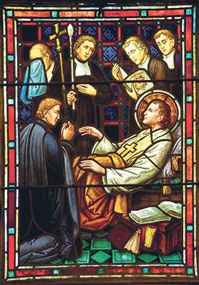 St John Baptist De La Salle on his death bed on a stained glass window at St Mary's College, California.