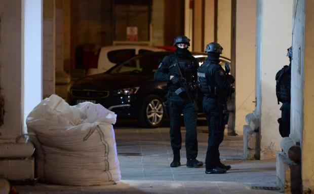 Members of the Malta Police Force guard the back door of the law courts as George Degiorgio, Alfred Degiorgio and Vincent Muscat enter the building in Valletta, on December 5 after being charged with the murder of blogger and journalist Daphne Caruana Galizia. The journalist was killed after a car bomb blew up the car she was in close to her home in Bidnija, on October 16. Photo: Matthew Mirabelli