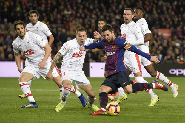 Barcelona's Lionel Messi scores his 400th La Liga goal against Eibar.