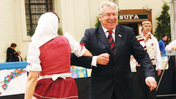 William Martin, head of the European Commission Representation in Malta, dancing with a member of the Aurora folk group. Top: a traditional wedding re-enactment.