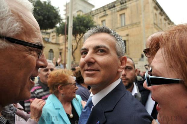 Opposition Leader Simon Busuttil is greeted by PN supporters upon arriving at the law courts in Valletta on April 6. Photo: Chris Sant Fournier