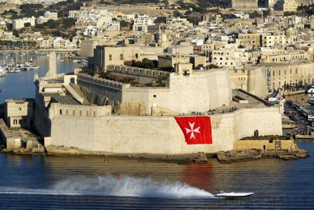 A powerboat speeds past Fort St Angelo during the Valletta Pageant of the Seas in Grand Harbour on June 7. The event was part of the Valletta 2018 festivities to mark the 450th anniversary since Valletta's foundation. Photo: Darrin Zammit Lupi