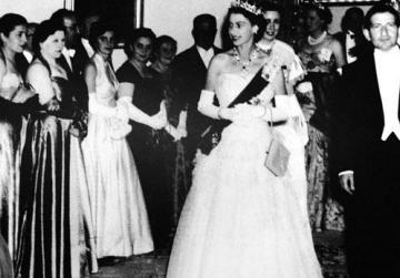 The Queen, accompanied by Prime Minister George Borg Olivier, at a reception given in her honour at Auberge d'Aragon, Valletta, during her 1954 visit.
